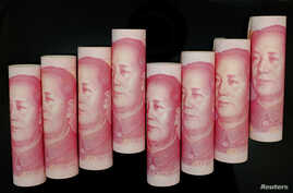FILE - 100 Yuan notes are seen in this illustration picture in Beijing.