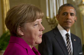 President Barack Obama and German Chancellor Angela Merkel participate in a joint news conference in the East Room of the White House in Washington, Feb. 9, 2015.