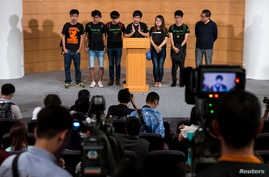 Scholarism convenor Joshua Wong (L-R), Hong Kong Federation of Students' Council member Nathan Law, Deputy Secretary-General Lester Shum, Secretary-General Alex Chow, Council member Yvonne Leung, General Secretary Eason Chung attend a news conference