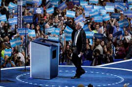 Former Democratic Presidential candidate, Sen. Bernie Sanders, I-Vt., takes the stage during the first day of the Democratic National Convention in Philadelphia, July 25, 2016.