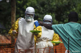 Medical staff working with Medecins sans Frontieres (MSF) prepare to bring food to patients kept in an isolation area at the MSF Ebola treatment centre in Kailahun July 20, 2014. Sierra Leone now has the highest number of Ebola cases, at 454, surpass