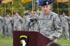 """FILE - U.S. Army Major General Gary Volesky speaks during a ceremony at Fort Campbell, Kentucky, Oct. 14, 2014. Volesky says Iraqi forces are making """"great progress"""" in reclaiming land lost to Islamic State militants."""