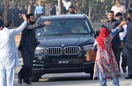 Maryam Nawaz, daughter of former Prime Minister Nawaz Sharif, right front passenger in vehicle, waves upon her arrival at an accountability court in Islamabad, Pakistan, Friday, Oct. 13, 2017.