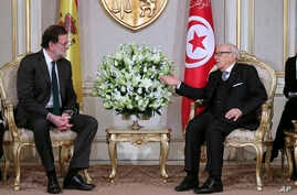 Tunisian President Beji Caid Essebsi, right, confers with Spanish Prime Minister Mariano Rajoy prior to their meeting at the presidential palace, in Carthage near Tunis, Tunisia, Monday, Feb. 26, 2018.