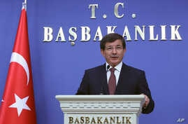 Turkey's new Prime Minister Ahmet Davutoglu announces his cabinet ministers in Ankara, Aug. 29, 2014.