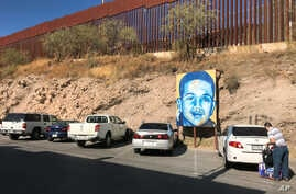 A portrait of 16-year-old Mexican youth Jose Antonio Elena Rodriguez, who was shot and killed in Nogales, Sonora, Mexico, is displayed on the street where he was killed that runs parallel with the U.S. border, Dec. 14, 2017. A U.S. border patrol agen