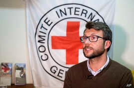 FILE - Pawel Krzysiek, the ICRC communication coordinator, speaks during an interview with The Associated Press in Damascus , Syria, Dec. 1, 2016.