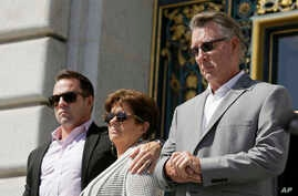 FILE - From left, Brad Steinle, Liz Sullivan and Jim Steinle, the brother, mother and father of Kate Steinle, who was shot to death on a pier, listen to a news conference on the steps of City Hall in San Francisco, Sept. 1, 2015. Steinle's  parents a