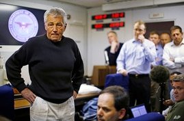 U.S. Defense Secretary Chuck Hagel aboard his military aircraft en route to Afghanistan,  March 8, 2013.