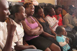 """""""Members of the Scars to Stars adult orphan support group discuss issues on July 1, 2012 in Nairobi. (VOA Photo/Jill Craig)"""