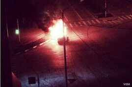 An unconfirmed video grab of a vehicle burning in a street in Grozny, Chechnya (via Twitter).