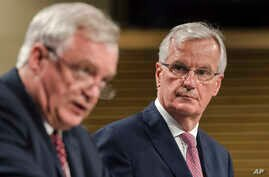 The EU chief Brexit negotiator Michel Barnier, right, and British Secretary of State David Davis address the media at EU headquarters in Brussels, July 20, 2017.