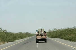 In this Feb. 12, 2018, file photo, Saudi-backed forces, ride in their vehicle, in Hodeida, Yemen.