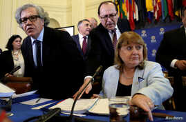 Organization of American States (OAS) Secretary General Luis Almagro (L) and Argentine Foreign Minister Susana Malcorra open a meeting of foreign ministers to discuss the situation in Venezuela in Washington, May 31, 2017.