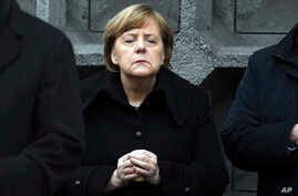 German Chancellor Angela Merkel, attends the opening of a memorial in Berlin, Dec. 19, 2017, to honor the victims of the Christmas market terrorist attack.