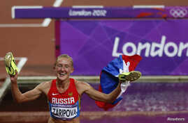 FILE - Russia's Yulia Zaripova celebrates after winning the women's 3000-meter steeplechase final at the London 2012 Olympic Games at the Olympic Stadium, Aug. 6, 2012.