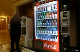 A soda vending machine sits in the basement of the state Capitol as members of the Legislature debate a ban on local soda taxes, June 28, 2018, in Sacramento, Calif. Lawmakers passed a bill to ban local taxes on soda for the next 12 years and sent it
