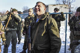Pro-Russian rebel leader Alexander Zakharchenko, center, surrounded by guards, Jan. 15, 2015.