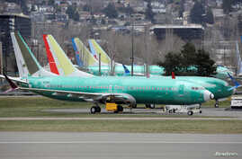 Boeing 737 Max aircraft, including a 737 Max 8 aircraft bearing the logo of China Southern Airlines (3rd left), are parked at a Boeing production facility in Renton, Washington, March 11, 2019.