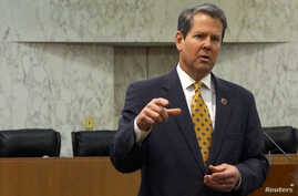 """FILE - Georgia Secretary of State Brian Kemp speaks with visitors to the state capitol about the """"SEC primary"""" involving a group of southern states voting next month in Atlanta, Feb. 24, 2016."""