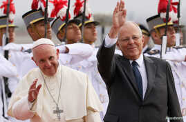 Pope Francis and Peru's President Pedro Pablo Kuczynski wave, in Lima, Peru, Jan. 18, 2018.