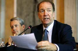 FILE - David Malpass, Undersecretary for International Affairs at the Treasury Dept., right, speaks about Brexit, during a meeting at the Treasury Department, in Washington, Oct. 16, 2018. .