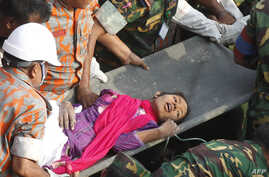 Bangladeshi rescuers retrieve garment worker Reshma from the rubble of a collapsed building in Savar on May 10, 2013.