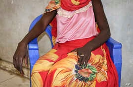 FILE - A young woman says that on a day in early November she and a friend were bound, dragged into the bush and raped by four men with guns, as she sits in a hospital in Nhialdu, South Sudan, Dec. 7, 2018.