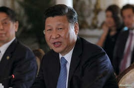 FILE - China's President Xi Jinping speaks during a bilateral meeting with U.S. President Donald Trump at Trump's Mar-a-Lago estate in Palm Beach, Florida, U.S., April 7, 2017.