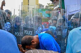 Policemen use pepper spray to disperse pro-opposition supporters during a protest in Male, Maldives, Feb. 16, 2017.