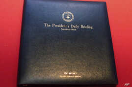 "FILE - The President's Daily Briefing ""PDB,"" a top secret leather binder, in which President Bush receives his daily intelligence reports is displayed at the ""Spies: Secrets from CIA, KGB, and Hollywood"" exhibit at the Ronald Reagan Presidential Libr"