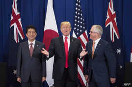Japan's Prime Minister Shinzo Abe, left, U.S. President Donald Trump and Australia Prime Minister Malcolm Turnbull attend a trilateral meeting during the opening ceremony of the 31st Association of South East Asian Nations (ASEAN) Summit in Manila on