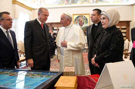 Pope Francis talks with Turkish President Tayyip Erdogan and his wife Emine (R) during a private audience at the Vatican, Feb. 5, 2018.