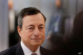 FILE - President of the European Central Bank, Mario Draghi, is on his way to a news conference after a meeting of the governing council in Frankfurt, Germany, Jan. 19, 2017.
