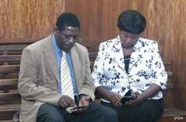 Treza Namathanga Senzani and her husband are shown in the courtroom shortly after her sentencing, Blantyre, Malawi, Oct. 8, 2014. (David Banda/VOA)