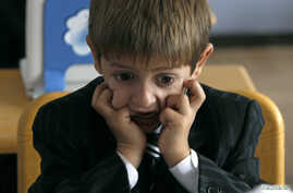 A first grader attends his first English language lesson at a local school in Tbilisi, September 15, 2010.