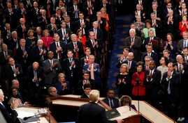 Republicans stand as President Donald Trump delivers his State of the Union address to a joint session of Congress on Capitol Hill in Washington, Tuesday, Feb. 5, 2019.