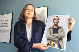 H&M Foundation Global Manager Diana Amini poses with portraits of women on its Foundation 500 list of female entrepreneurs in emerging markets in Stockholm, Sweden, June 2, 2017.