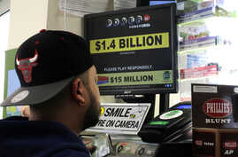 A man buys Powerball tickets at a convenience store in Lancaster, Pa., Jan. 11, 2016.