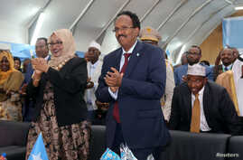 Somalia's newly elected President Mohamed Abdullahi Farmaajo and his wife Zeinab Abdi applaud during his inauguration ceremony in Somalia's capital Mogadishu, Feb. 22, 2017.