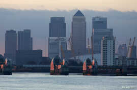 FILE - London's financial district is seen behind the Thames Barrier late afternoon December 1, 2013