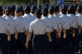 In this June 22, 2012, image taken from video, female airmen march during graduation at Lackland Air Force Base in San Antonio, Texas..
