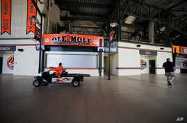 A Baltimore Orioles employee drives through the stadium concourse before the Chicago White Sox and Baltimore Orioles baseball game, in Baltimore, April 29, 2015.