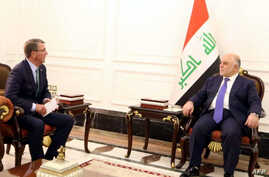 A handout picture released by the Iraq prime minister's press office shows Iraqi Prime Minister Haidar al-Abadi, right, meeting with U.S. Secretary of Defense Ash Carter in Baghdad, Oct. 22, 2016.