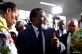 Democratic Republic of Congo President Joseph Kabila displays ink on his hand after casting his vote at a polling station in Kinshasa,  Dec. 30, 2018.