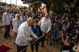 Cuba's Minister of Foreign Trade Rodrigo Malmierca, right, watches as Vice President of Cuba's Council of Ministers Ricardo Cabrisas Ruiz, left, cuts the ribbon at the opening of the 34th Trade Fair in Havana, Cuba, Monday, Oct. 31, 2016. A week-long