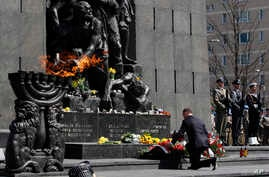 Polish President Andrzej Duda lays a wreath during state ceremonies in homage to the victims and fighters of the 1943 Warsaw Ghetto Uprising, on the 75th anniversary of the start of the revolt, in front of the Monument to the Warsaw Ghetto Heroes, in