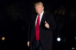 President Donald Trump gives a thumbs up to members of the media as he arrives at the White House in Washington, Feb. 20, 2017.