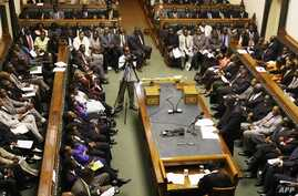 FILE - Prime Minister Morgan Tsvangirai (R) delivers his first speech as Prime Minister at the Zimbabwean parliament in Harare, March 4, 2009.