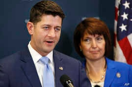 House Speaker Paul Ryan of Wis., (L) speaks next to Rep. Cathy McMorris Rodgers, R-Wash., during a news conference following a GOP caucus meeting, July 24, 2018, on Capitol Hill in Washington.